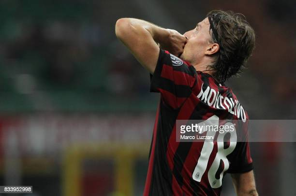 Riccardo Montolivo of AC Milan celebrates his second goal during the UEFA Europa League Qualifying PlayOffs round first leg match between AC Milan...