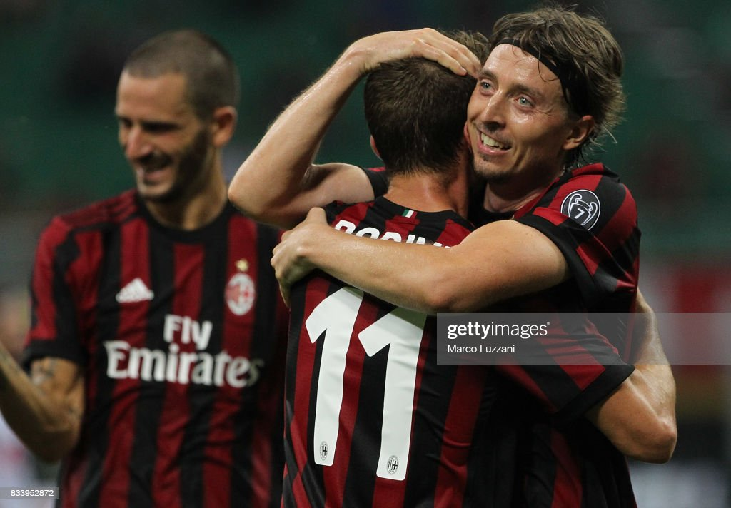 Riccardo Montolivo of AC Milan celebrates his second goal with his team-mate Fabio Borini #11 during the UEFA Europa League Qualifying Play-Offs round first leg match between AC Milan and KF Shkendija 79 at Stadio Giuseppe Meazza on August 17, 2017 in Milan, Italy.