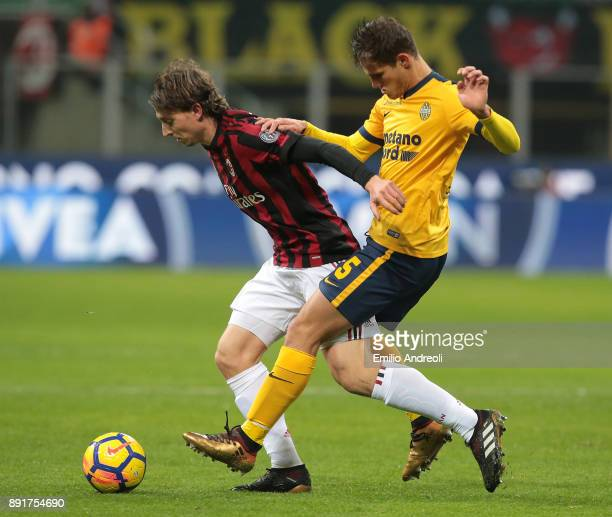 Riccardo Montolivo of AC Milan competes for the ball with Bruno Zuculini of Hellas Verona during the Tim Cup match between AC Milan and Hellas Verona...