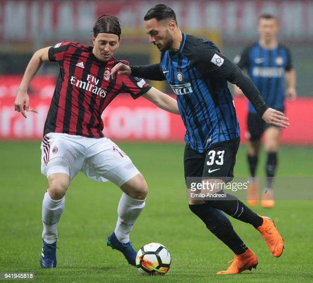 Riccardo Montolivo of AC Milan competes for the ball with Danilo D Ambrosio of FC Internazionale Milano during the Serie A match between AC Milan and...