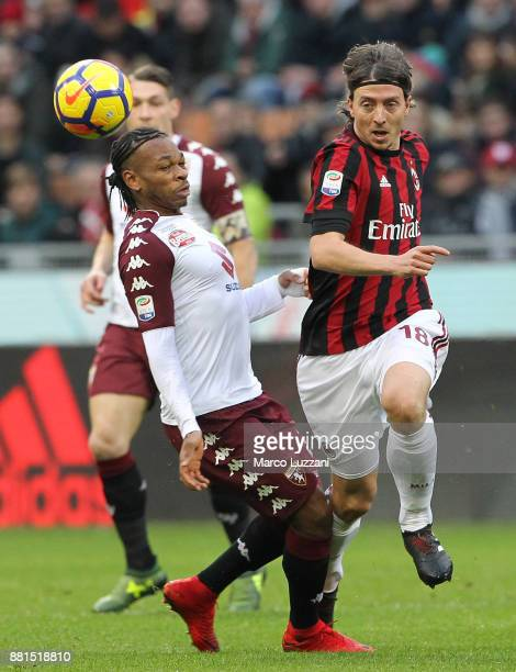 Riccardo Montolivo of AC Milan competes for the ball with Joel Obi of Torino FC during the Serie A match between AC Milan and Torino FC at Stadio...