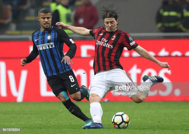Riccardo Montolivo of AC Milan is challenged by Rafinha Alcantara of FC Internazionale during the erie A match between AC Milan and FC Internazionale...