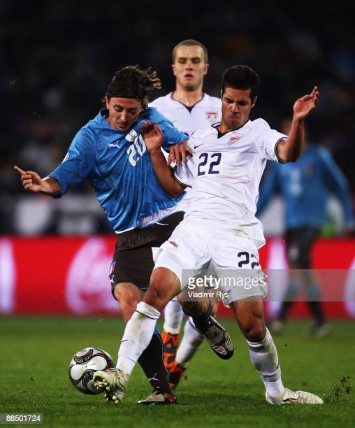 Riccardo Montolivo of Italy and Benny Feilhaber of the USA compete for the ball during the FIFA Confederations Cup match between USA and Italy at...