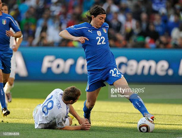 Riccardo Montolivo of Italy moves away from Erik Jendrisek of Slovakia during the 2010 FIFA World Cup South Africa Group F match between Slovakia and...