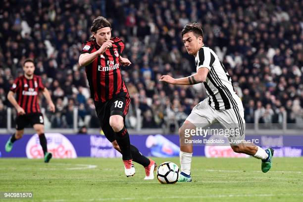 Riccardo Montolivo of Milan and Paulo Dybala of Juventus in action during the serie A match between Juventus and AC Milan at Allianz Stadium on March...