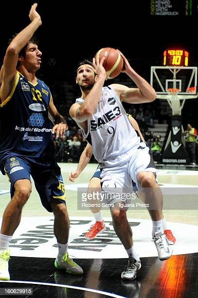 Riccardo Moraschini of SAIE3 competes with Luca Campani of Sutor during the LegaBasket Serie A match between Virtus Bologna SAIE3 and Sutor...