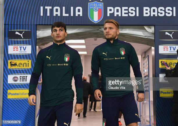 Riccardo Orsolini and Ciro Immobile of Italy arrive for a training session at Gewiss Stadium on October 13, 2020 in Bergamo, Italy.