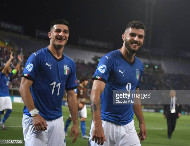 Riccardo Orsolini and Patrick Cutrone of Italy celebrate at the end of the 2019 UEFA U21 Group A match between Italy and Spain at Renato Dall'Ara...