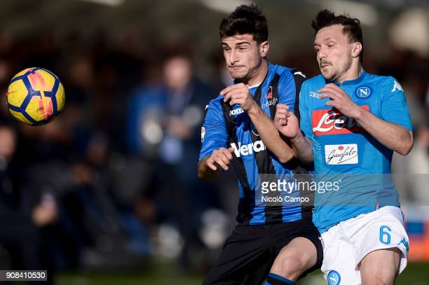 Riccardo Orsolini of Atalanta BC competes for the ball with Mario Rui of SSC Napoli during the Serie A football match between Atalanta BC and SSC...