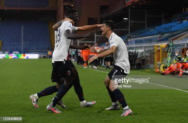 Riccardo Orsolini of Bologna FC celebrates goal with teammates Musa Barrow of Bologna FC and Mitchell Dijks of Bologna FC during the Serie A match...