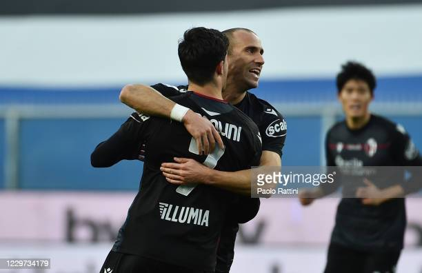 Riccardo Orsolini of Bologna FC celebrates with Lorenzo de Silvestri after scoring 11 during the Serie A match between UC Sampdoria and Bologna FC at...