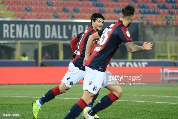 Riccardo Orsolini of Bologna FC celebrates with teammate Mitchell Dijks after scoring the opening goal during the Coppa Italia match between Bologna...