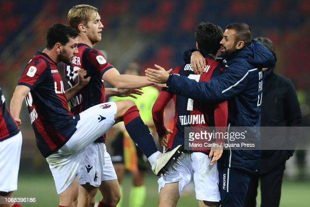 Riccardo Orsolini of Bologna FC celebrates with teammates after scoring the opening goal during the Coppa Italia match between Bologna FC and Crotone...