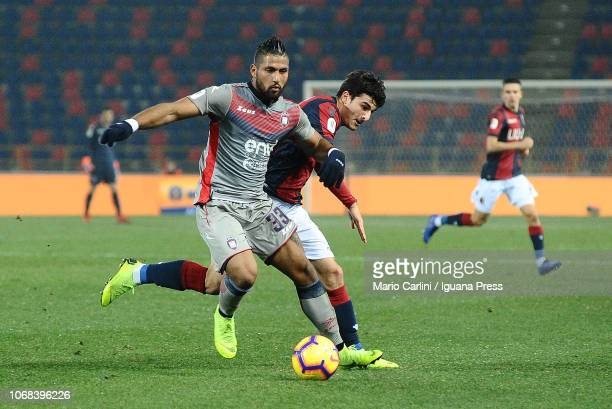 Riccardo Orsolini of Bologna FC competes for the ball against Aristóteles Romero of Cronote FC during the Coppa Italia match between Bologna FC and...