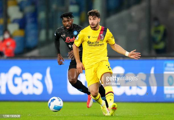 Riccardo Orsolini of Bologna FC competes for the ball with Andre-Frank Zambo Anguissa of SSC Napoli ,during the Serie A match between SSC Napoli and...