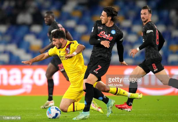 Riccardo Orsolini of Bologna FC competes for the ball with Elif Elmas of SSC Napoli ,during the Serie A match between SSC Napoli and Bologna FC at...