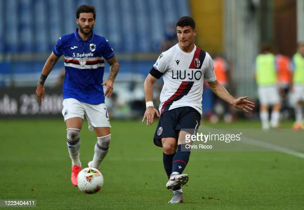 Riccardo Orsolini of Bologna FC evades challenge from Nicola Murru of UC Sampdoria during the Serie A match between UC Sampdoria and Bologna FC at...