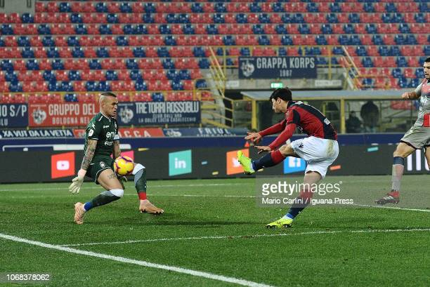 Riccardo Orsolini of Bologna FC scores the opening goal against the defense of Alex Cordaz of Crotone during the Coppa Italia match between Bologna...