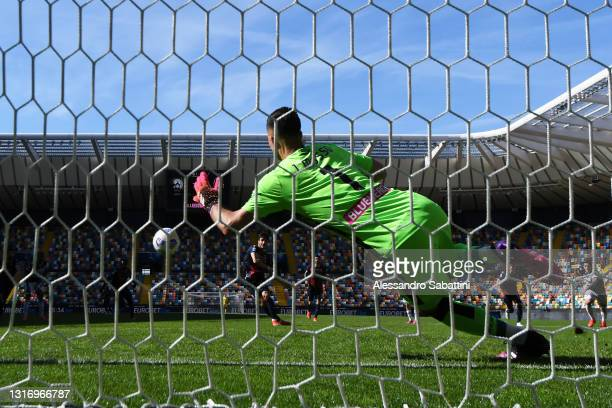 Riccardo Orsolini of Bologna FC scores their team's first goal from the penalty spot during the Serie A match between Udinese Calcio and Bologna FC...