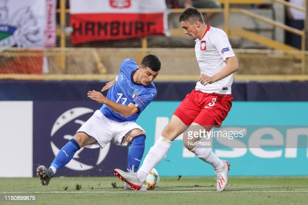 Riccardo Orsolini of Italy U21 and Kamil Pestka of Poland U21 during the UEFA UNDER21 Championship match between Italy and Poland at Renato Dall'Ara...