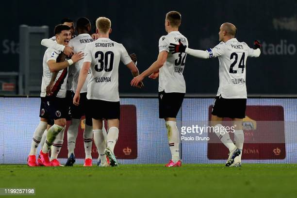 Riccardo Orsolini with his teammates of Bologna FC celebrates after scoring the opening goal during the Serie A match between AS Roma and Bologna FC...