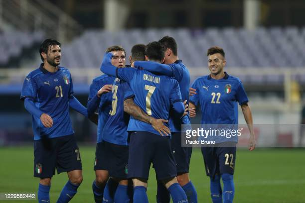 Riccardo Orsolini with his teammates of Italy celebrates after scoring the team's fourth goal from penalty spot during the international friendly...