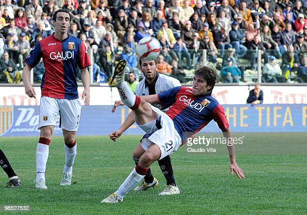 Riccardo Pasi of Parma FC competes for the ball with Alberto Zapater of Genoa CFC during the Serie A match between Parma FC and Genoa CFC at Stadio...