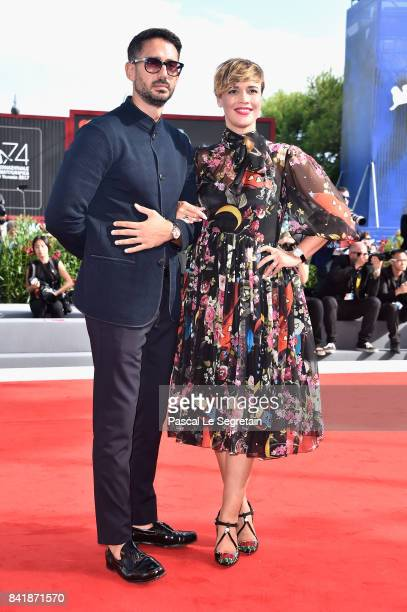 Riccardo Pasquale and Roberta Giarrusso walk the red carpet ahead of the 'Foxtrot' screening during the 74th Venice Film Festival at Sala Grande on...