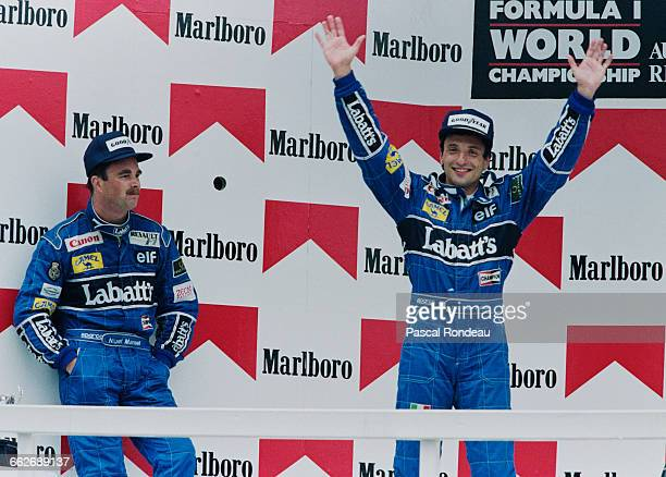 Riccardo Patrese of Italy driver of the Canon Williams Renault Williams FW14 Renault RS3 V10 celebrates after winning as his second placed team mate...