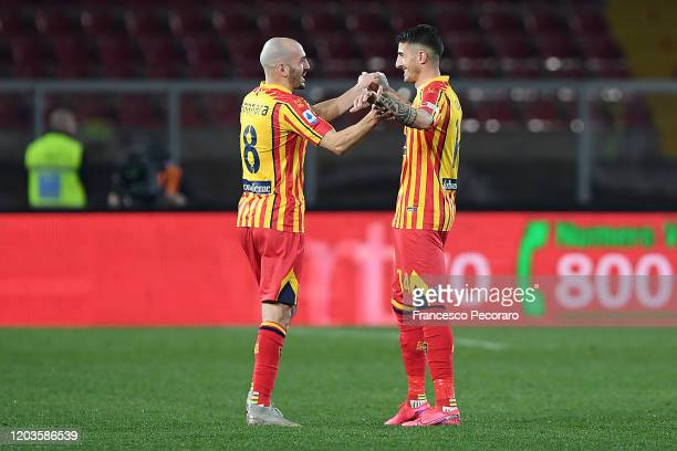 Riccardo Saponara and Alessandro Deiola of US Lecce celebrate the 10 goal scored by Alessandro Deiola during the Serie A match between US Lecce and...