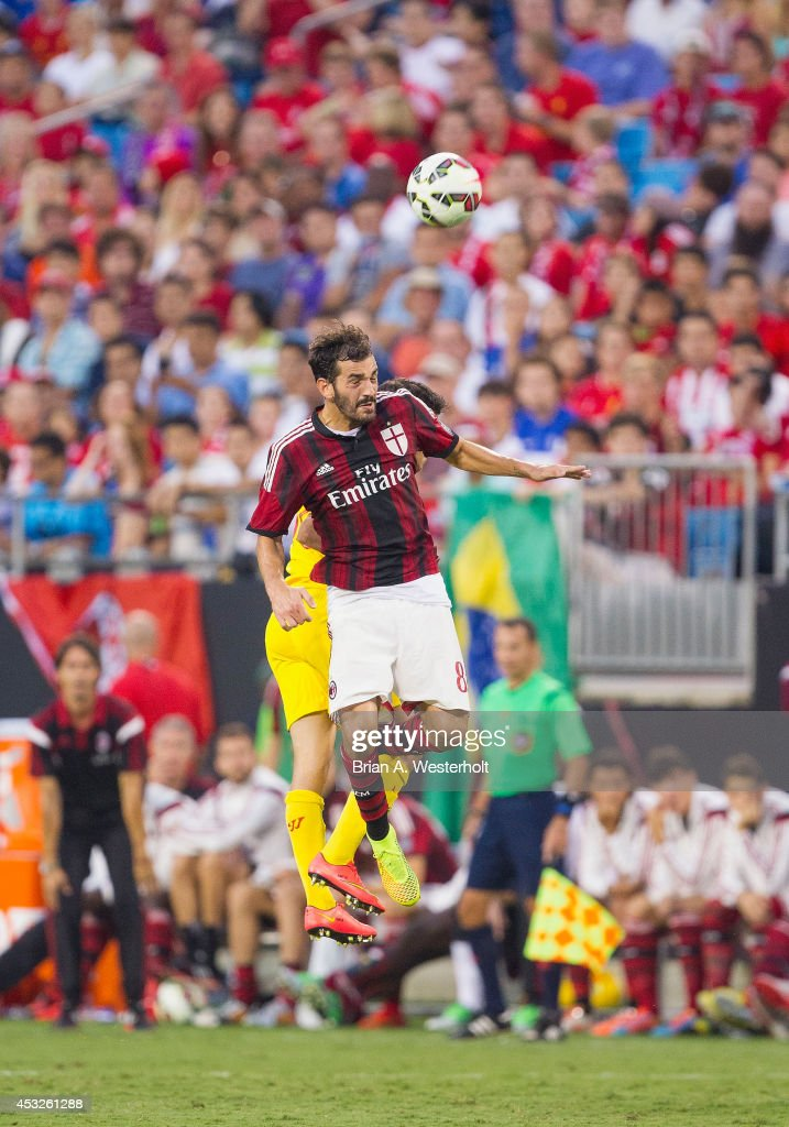 Riccardo Saponara #8 of A.C. Milan battles for a jump ball with Phillipe Coutinho #10 of Liverpool in the Guinness International Champions Cup at Bank of America Stadium on August 2, 2014 in Charlotte, North Carolina. Liverpool defeated A.C. Milan 2-0.