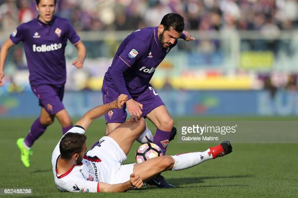 Riccardo Saponara of ACF Fiorentina battles for the ball with Panagiotis Tachtsidis of Cagliari Calcio during the Serie A match between ACF...
