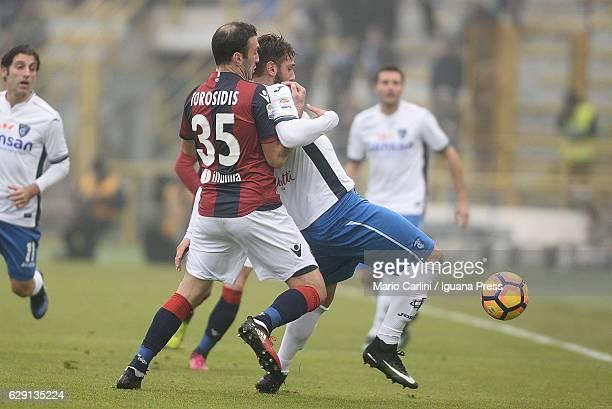 Riccardo Saponara of Empoli FC comptes the ball with Vasilis Torosidis of Bologna FC during the Serie A match between Bologna FC and Empoli FC at...