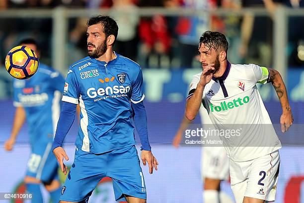 Riccardo Saponara of Empoli Fc for the ball with Gonzalo Rodriguez of ACF Fiorentina during the Serie A match between Empoli FC and ACF Fiorentina at...