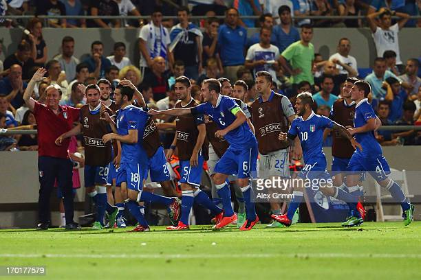Riccardo Saponara of Italy celebrates his team's first goal with team mates during the UEFA European U21 Championship Group A match between Italy and...