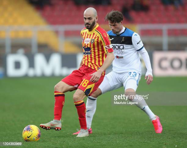 Riccardo Saponara of Lecce competes for the ball with Hans Hateboer of Atalanta during the Serie A match between US Lecce and Atalanta BC at Stadio...