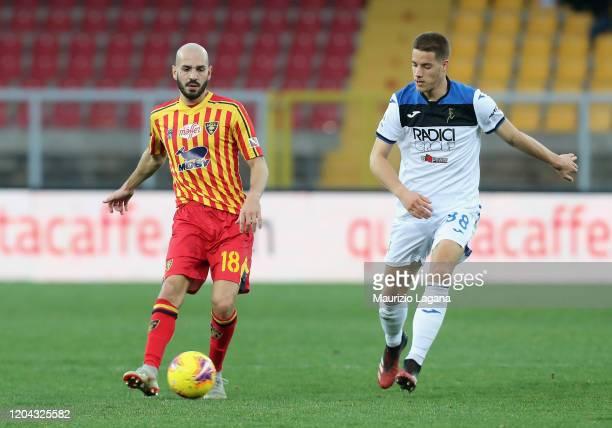 Riccardo Saponara of Lecce competes for the ball with Mario Pasalic of Atalanta during the Serie A match between US Lecce and Atalanta BC at Stadio...