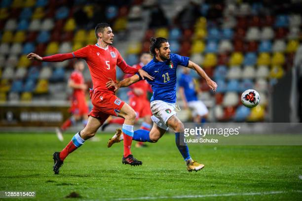 Riccardo Scottil of Italy challenges for the ball with Edin Osmanovic of Luxembourg during the UEFA Euro Under 21 Qualifier match between Luxembourg...