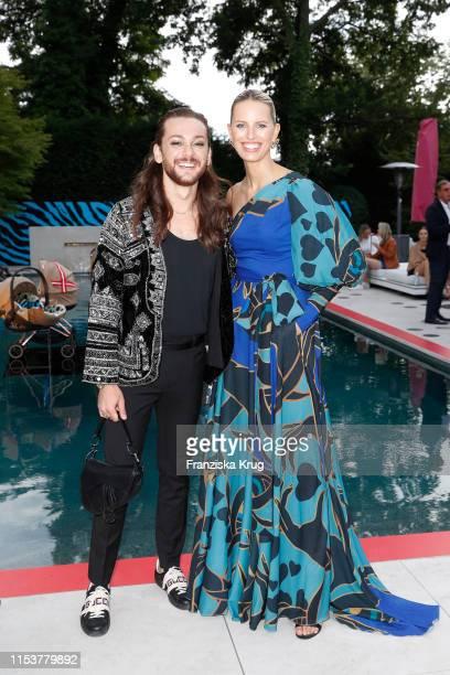 Riccardo Simonetti and Karolina Kurkova during the CYBEX by Karolina Kurkova 4th of July Fashion BBQ at Villa Westend on July 4 2019 in Berlin Germany