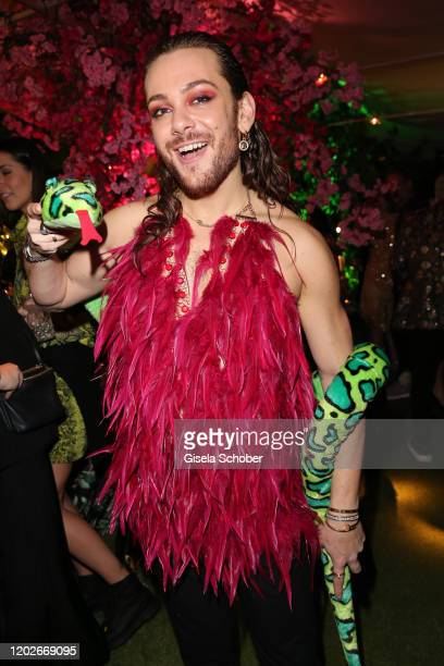 """Riccardo Simonetti and snake during the Place To B Berlinale Party """"Garden of Eden"""" at Borchardt Restaurant on February 22, 2020 in Berlin, Germany."""