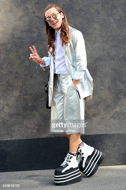Riccardo Simonetti wearing Buffalo shoes a suite of Monki a Kelvin Klein shirt and glasses of Dior during the MercedesBenz Fashion Week Berlin...