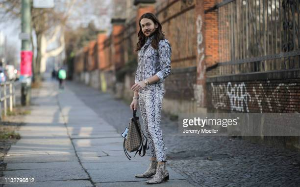 Riccardo Simonetti wearing pants and shirt from ASOS Jeffery West shoes Gucci bag and Cartier jewelry on February 28 2019 in Berlin Germany