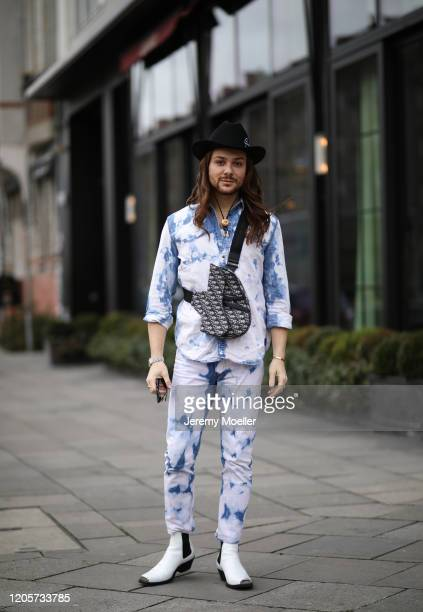 Riccardo Simonetti wearing Versace cowboy hat, Dior saddle bag, Calvin Klein boots and Diesel jeans and jacket on February 11, 2020 in Berlin,...