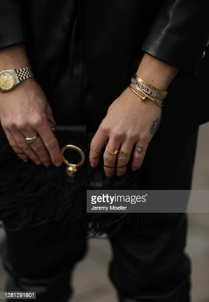 Riccardo Simonetti wearing Zara leather pants, Topshop bag and Zara leather blazer on October 20, 2020 in Berlin, Germany.