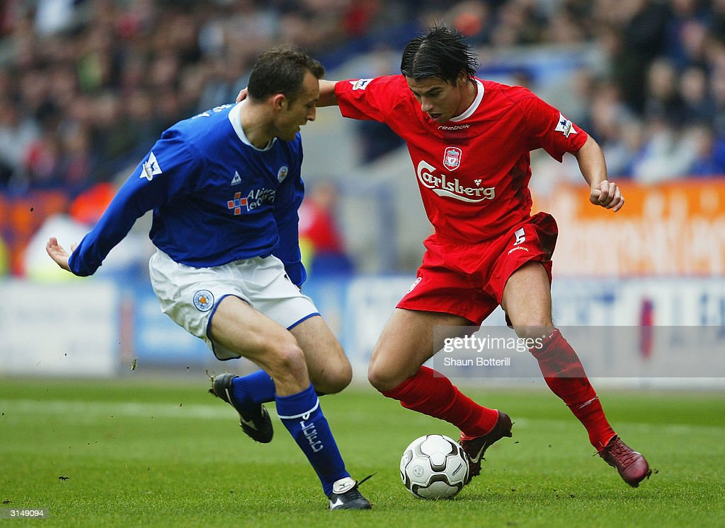 Riccardo Smicea of Leicester City challenges Milan Baros of Liverpool during the FA Barclaycard Premiership match between Leicester City and Liverpool at The Walkers Stadium on March 28, 2004 in Leicester, England.