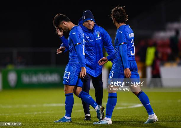 Riccardo Sottil and Luca Pellegrini of Italy look dejected following the UEFA U21 Championships Qualifier match between the Republic of Ireland and...