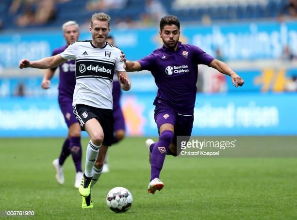 Riccardo Sottil of Florenz challenges Andre Schuerrle of Fulham during the final match between FC Fulham and AC Florenz at SchauinslandReisenArena on...