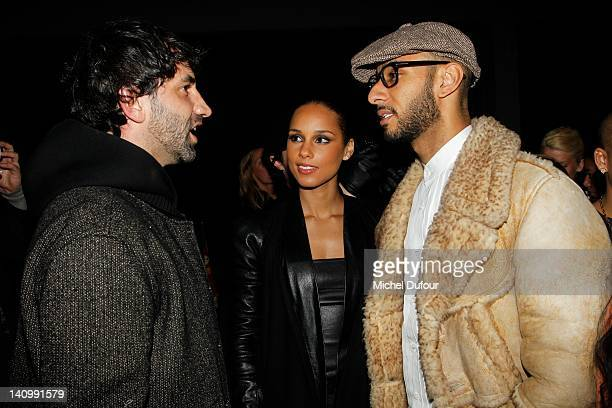 Riccardo Tisci Alicia Keys and Swizz Beatz attend the Kanye West ReadyToWear Fall/Winter 2012 show as part of Paris Fashion Week at Halle Freyssinet...