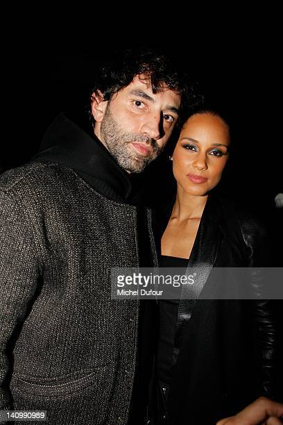 Riccardo Tisci and Alicia Keys attend the Kanye West ReadyToWear Fall/Winter 2012 show as part of Paris Fashion Week at Halle Freyssinet on March 6...