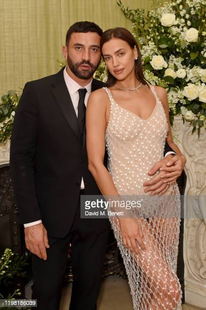 Riccardo Tisci and Irina Shayk attend the British Vogue and Tiffany Co Fashion and Film Party at Annabel's on February 2 2020 in London England